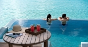 Anantara_Veli_Maldives_Overwater_Pool_Suite_lifestyle_couple_1920x1037