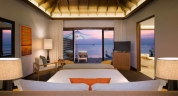 Anantara_Veli_Maldives_Deluxe_Over_Water_Pool_Bungalow_bedroom_1920x1037