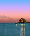 one-and-only-reethi-rah-maldives_Water Villa Exterior sunset
