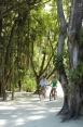 (N)80c004h - Couple cycling around the resort
